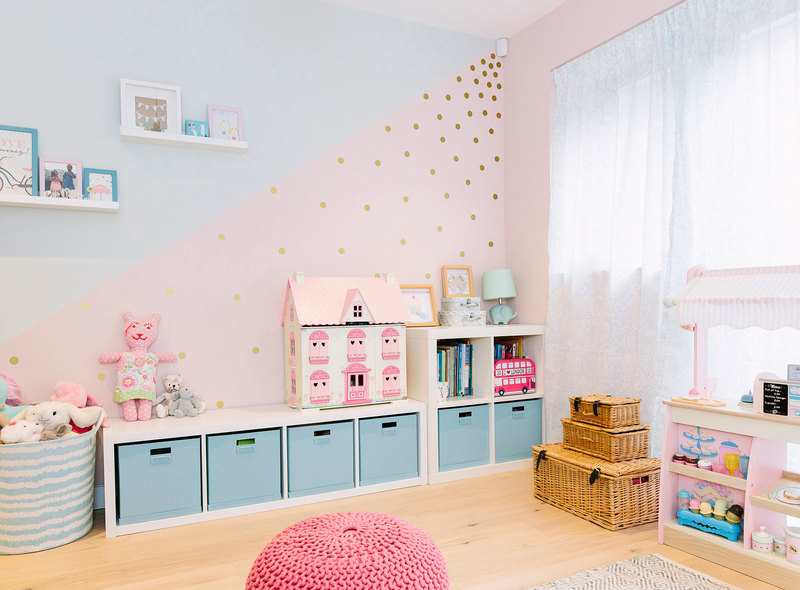 Baby pink and pale turquoise children's bedroom with plenty of storage and fun