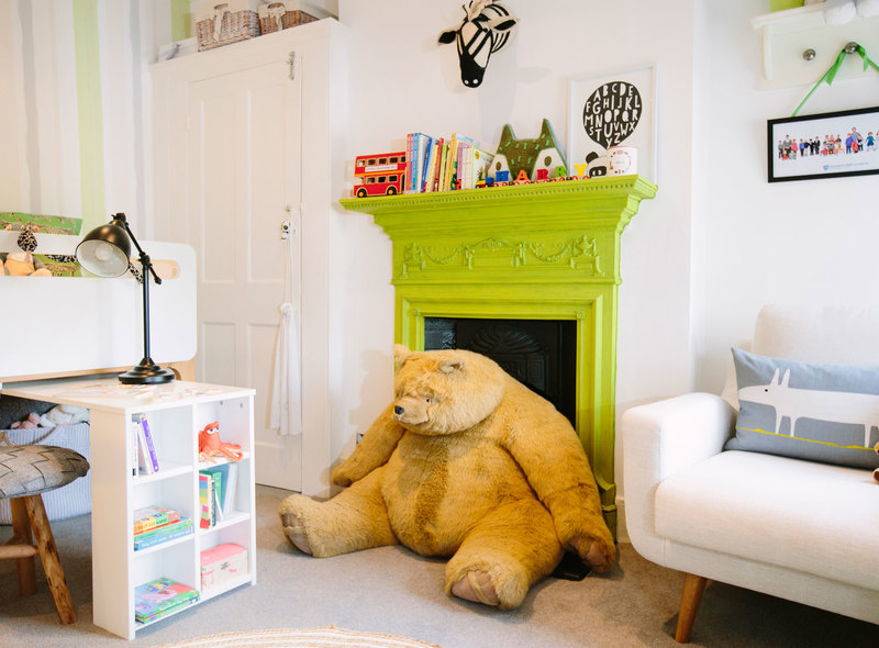 Lime green painted fireplace with toys and fun for a gender neutral children's bedroom