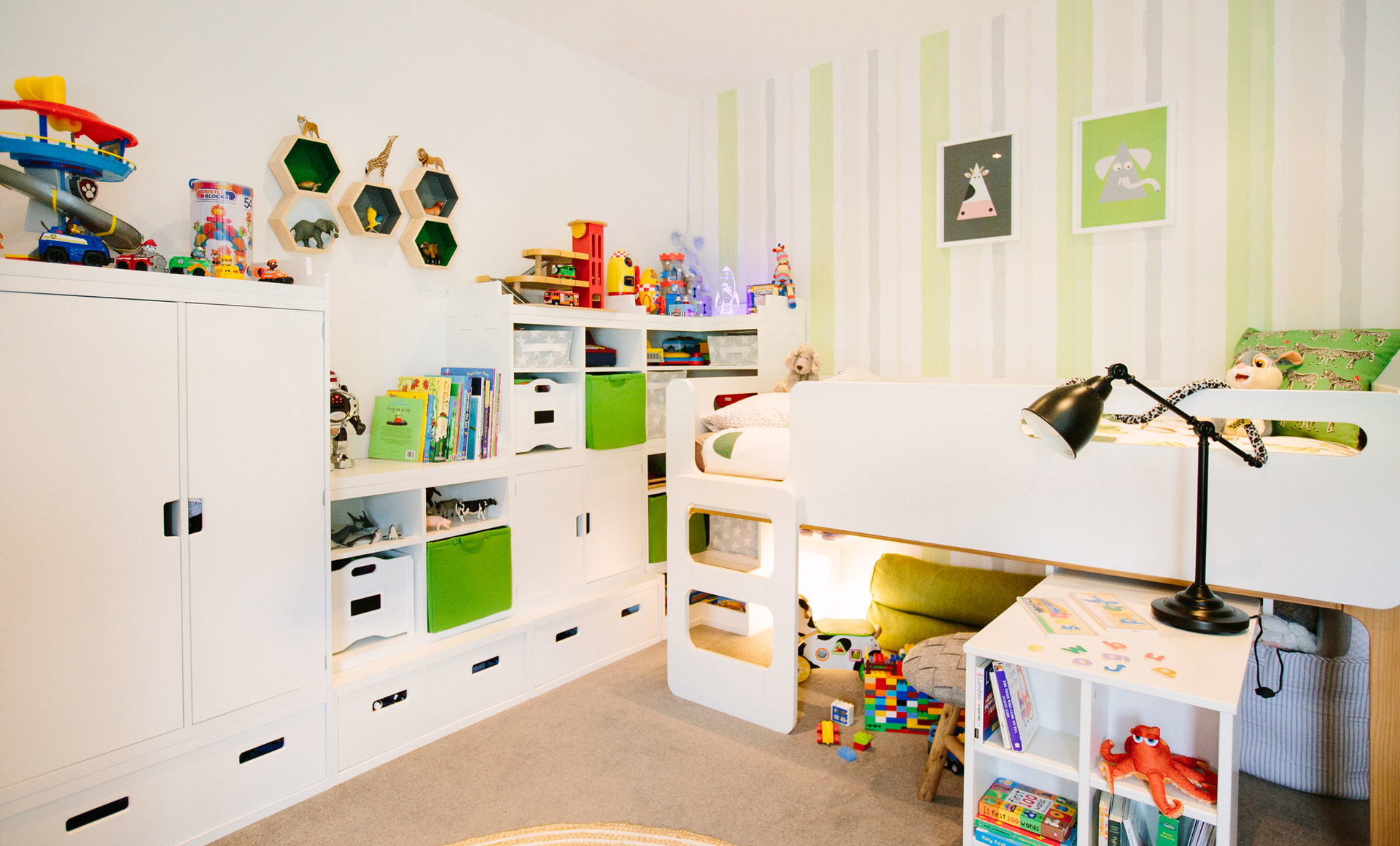 Bundles of storage in a children's bedroom for a little boy with lots of toys and loves to play