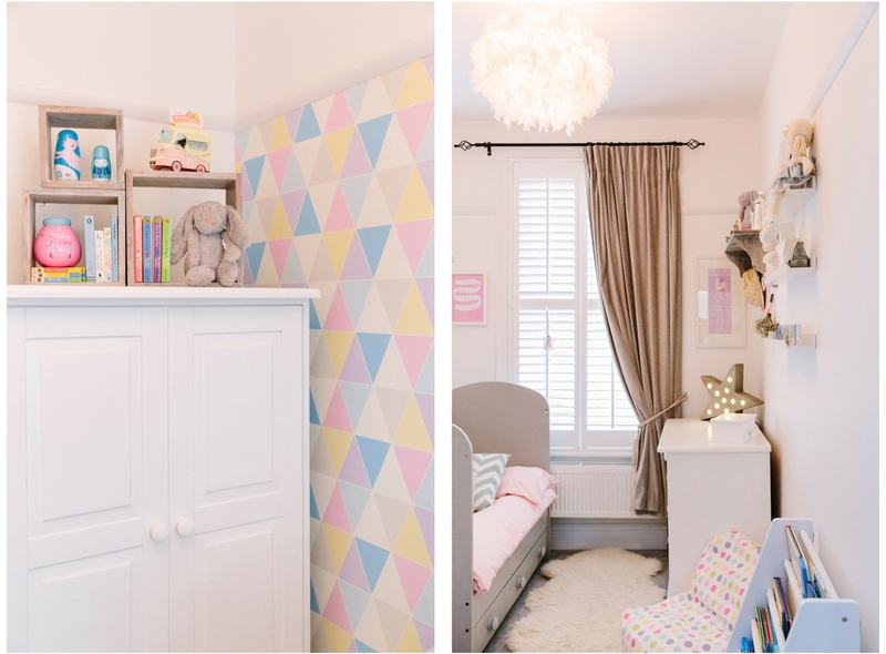 Geometric pastel coloured wallpaper with a fluffy cloud ceiling light and faux fur makes a cosy children's bedroom