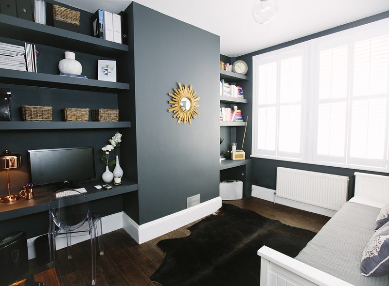 Built in bespoke shelving and desk space in the alcoves in statement deep blue paint