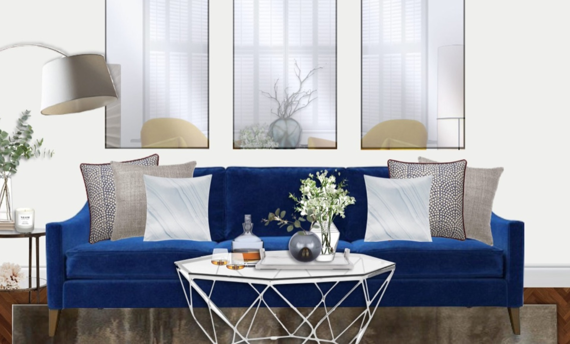 Bright blue velvet sofa with trio of mirrors, silver furniture finishes and indoor greenery