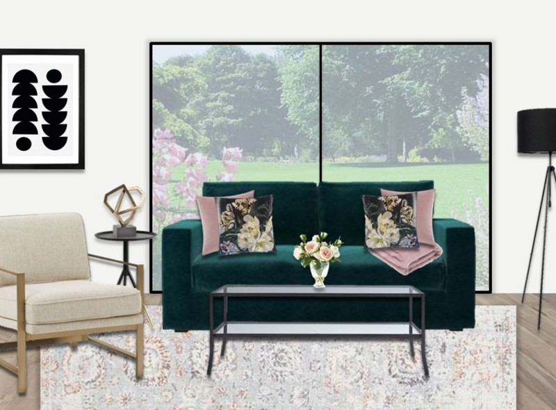 Emerald, blush and brass living room with black finishes.