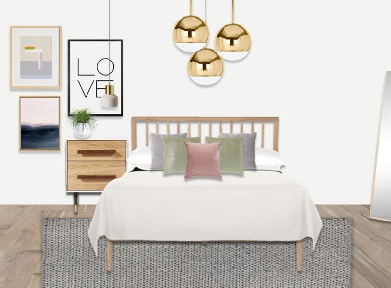Light wood and pastel colours for a Scandinavian bedroom with brass lighting and a gallery wall