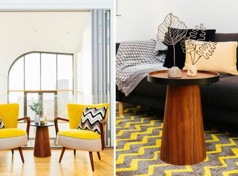 Bright yellow midcentury occasional chairs with dark wood accents and a dark stained wood tray table