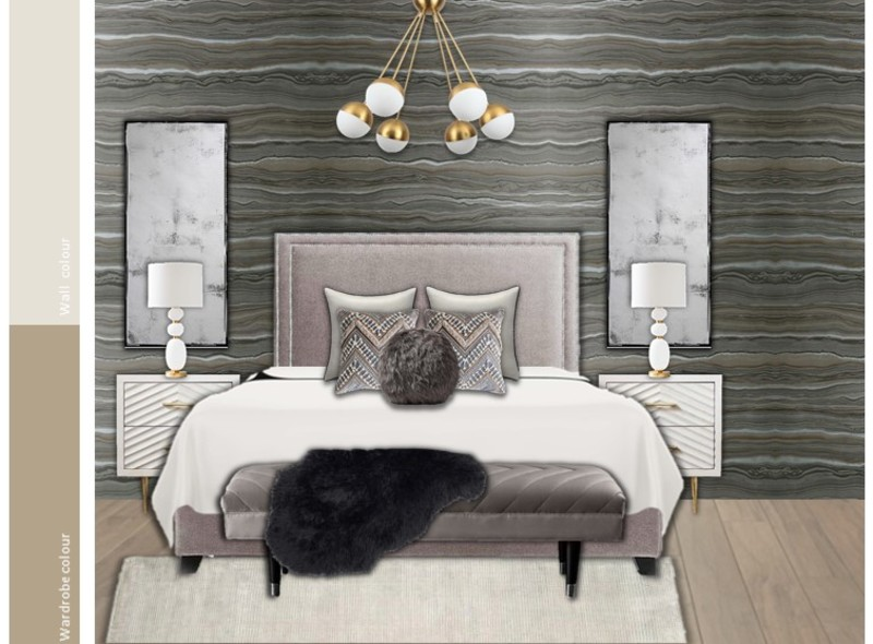 A sophisticated and luxe master bedroom with brass accents
