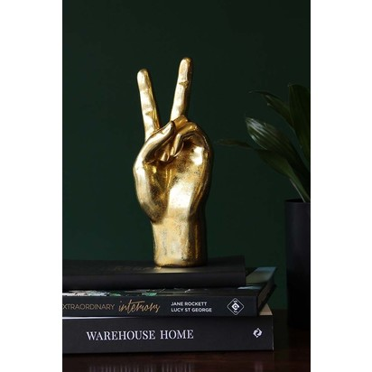 Rockettstgeorge gold peace hand ornament lifestyle lowres